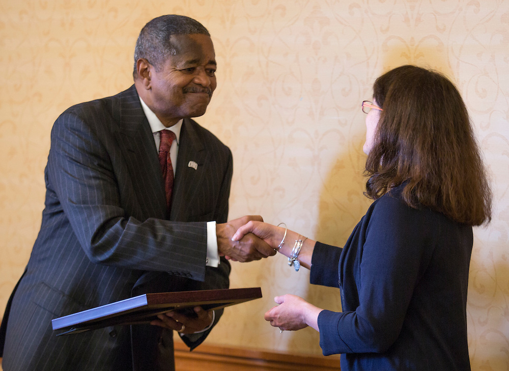 President McDavis shakes the hand of for Dr. Lauren McMills, an assistant professor of chemistry, a Presidential Teaching Award finalist, at the Presidential Teacher award ceremony in Baker Center, on Monday, September 31, 2015. Photo by Kaitlin Owens