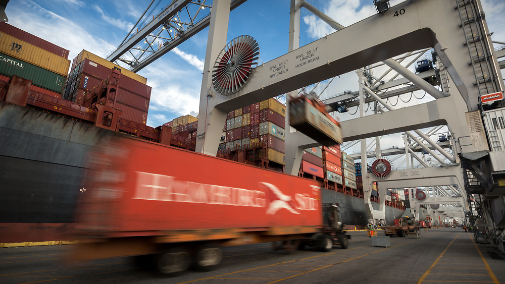 HOLD FOR JENNY KANE** In this July, 5, 2018 photo, a post-Panamax crane loads a 40-foot shipping container onto a container ship, Thursday, July 5, 2018, at the Port of Savannah in Savannah, Ga. The U.S. hiked tariffs on Chinese imports Friday and Beijing said it immediately retaliated in a dispute between the world's two biggest economies. (AP Photo/Stephen B. Morton)
