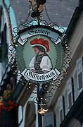 Deutschland, Germany,Baden-Wuerttemberg.Schwarzwald.Wolfach, Gasthausschild mit Frau in Bollenhuttracht.Wolfach, pub sign with woman in traditional costume...