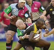 Photo Peter Spurrier<br /> 17/11/2002<br /> Zurich Premiership Rugby - Harlequins v Wasps<br /> Paul Burke tackles Ayoola Erinie [Mandatory Credit:Peter SPURRIER/Intersport Images]