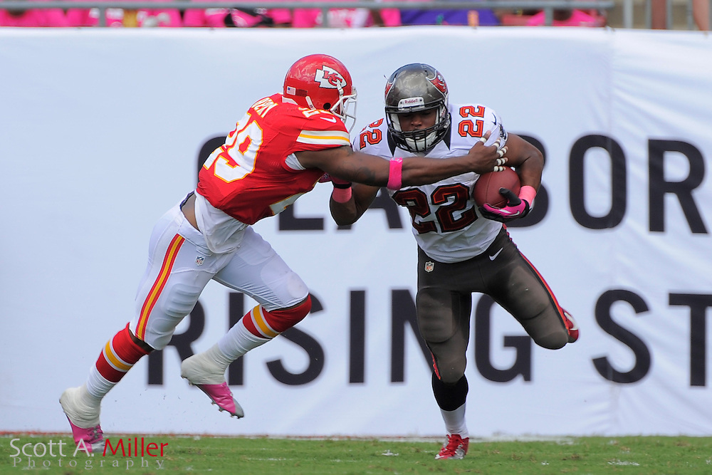 Tampa Bay Buccaneers running back Doug Martin (22) is tackled by Kansas City Chiefs strong safety Eric Berry (29) the Bucs 38-10 win at Raymond James Stadium  on Oct. 14, 2012 in Tampa, Florida. The Bucs won38-10...(SPECIAL TO FOXSPORTS.COM/Scott A. Miller)...