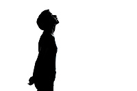one caucasian young teenager silhouette boy or girl looking up portrait in studio cut out isolated on white background
