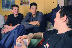 Group of teenage boys sitting together talking,