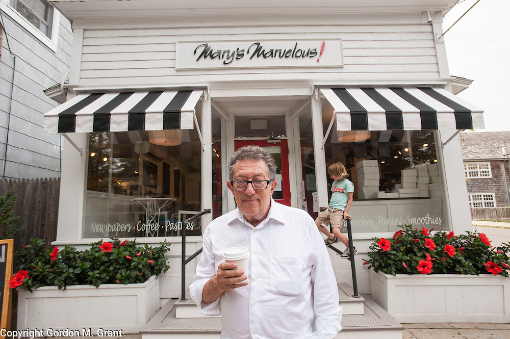Freddie Stolmack, the owner of Weatherproof Garment Company, stands outside Mary's Marvelous, a sandwich shop in Amagansett that he supports by doing an ad campaign in local publications. (August 8, 2012)