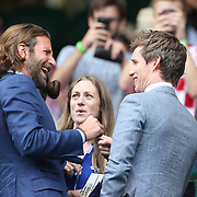 LONDON, ENGLAND - JULY 16: Eddie Redmayne and his wife Hannah Bagshawe talk with Bradley Cooper at the Mens Singles Final between Roger Federer of Switzerland and Marin Cilic of Croatia during the Wimbledon Lawn Tennis Championships at the All England Lawn Tennis and Croquet Club at Wimbledon on July 16, 2017 in London, England. (Photo by Tim Clayton/Corbis via Getty Images)