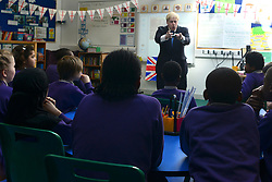 "© Licensed to London News Pictures. 23/04/2013. London, UK Mayor of London, Boris Johnson takes part in a Year 6 Class about St George's Day at Tidehall Academy in Deptford, South East London today 23rd April 2013. The class was taught by ""Outstanding Teacher"" Ed Wickstead. During the lesson Mr jOhnson wore a ""sound field"" device around his neck so his voice could be heard by the class. Photo credit : Stephen Simpson/LNP"