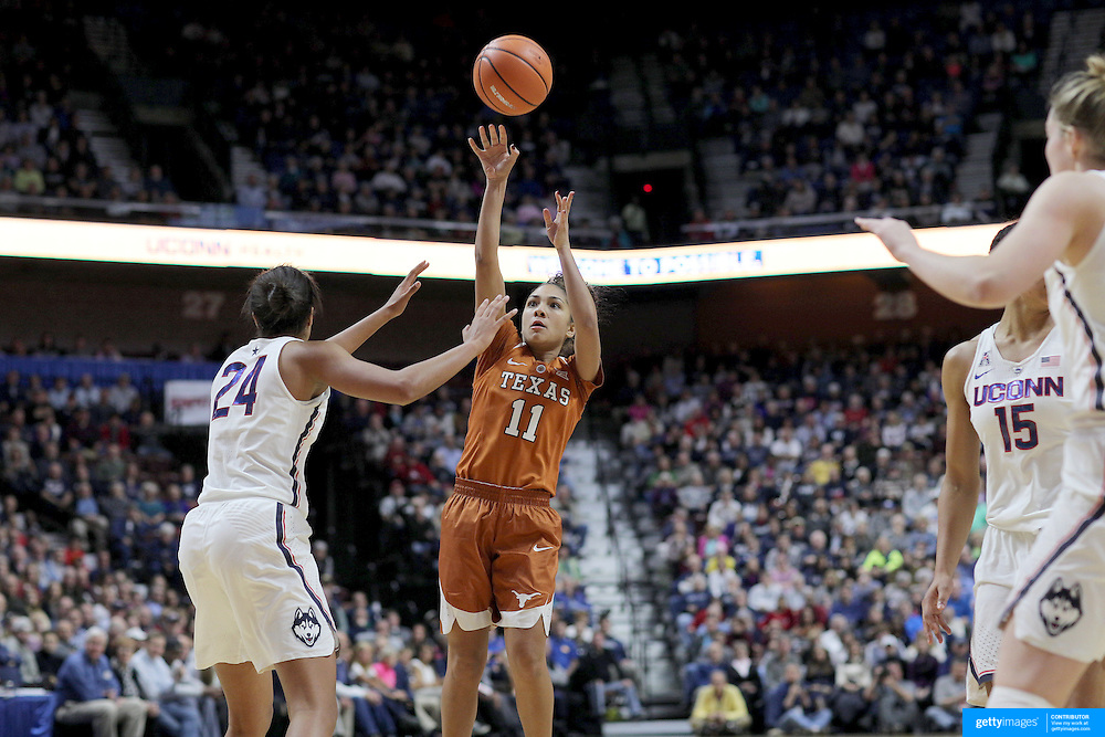 UNCASVILLE, CONNECTICUT- DECEMBER 4:  Brooke McCarty #11 of the Texas Longhorns shoots while defended by Napheesa Collier #24 of the Connecticut Huskies during the UConn Huskies Vs Texas Longhorns, NCAA Women's Basketball game in the Jimmy V Classic on December 4th, 2016 at the Mohegan Sun Arena, Uncasville, Connecticut. (Photo by Tim Clayton/Corbis via Getty Images)