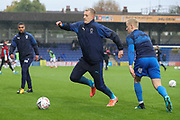 AFC Wimbledon striker Joe Pigott (39) battles for possession with AFC Wimbledon defender Archie Procter (35) whilst warming up during the The FA Cup match between AFC Wimbledon and Doncaster Rovers at the Cherry Red Records Stadium, Kingston, England on 9 November 2019.
