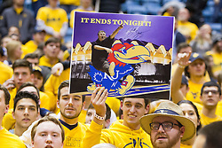 Jan 24, 2017; Morgantown, WV, USA; A West Virginia Mountaineers fan holds up a sign after beating the Kansas Jayhawks at WVU Coliseum. Mandatory Credit: Ben Queen-USA TODAY Sports