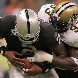 2008 October, 12: New Orleans Saints defensive end Bobby McCray (93) sacks Oakland Raiders quarterback JaMarcus Russell (2) during the fourth quarter of a 34-3 Saints victory over the Raiders at the Louisiana Superdome in New Orleans, LA.