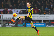 Burton Albion midfielder Tom Naylor controls the ball as he scores Burton's second goal during the Sky Bet League 1 match between Burton Albion and Bradford City at the Pirelli Stadium, Burton upon Trent, England on 6 February 2016. Photo by Aaron Lupton.