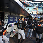 NEW YORK, NEW YORK - APRIL 12: Ichiro Suzuki, Miami Marlins, with manager Don Mattingly in the dugout as Dee Gordon looks on during the Miami Marlins Vs New York Mets MLB regular season ball game at Citi Field on April 12, 2016 in New York City. (Photo by Tim Clayton/Corbis via Getty Images)