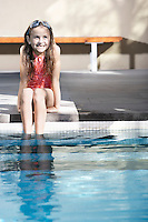 Young Girl Sitting By the Pool