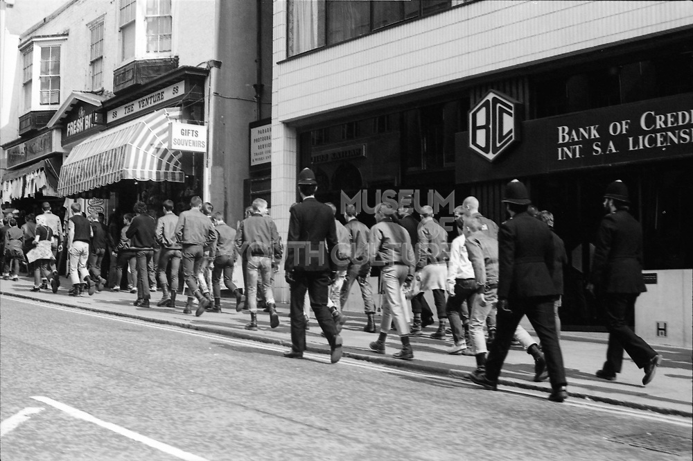 Police walking with Skinheads, Brighton, UK, 1980's
