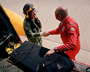 Member of the Red Arrows, Britain's RAF aerobatic team handshakes his helicopter ride's pilot after landing.