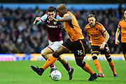 Wolverhampton Wanderers defender (on loan from Porto ) Willy Boly (15) battles for possession  with Aston Villa midfielder Jack Grealish (10) during the EFL Sky Bet Championship match between Aston Villa and Wolverhampton Wanderers at Villa Park, Birmingham, England on 10 March 2018. Picture by Dennis Goodwin.