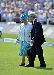 © Licensed to London News Pictures. 18/07/2013. Queen Elizabeth II is introduced to the Australian team by captain Michael Clarke y with MCC President Mike Griffith (R) prior to day one of  Second Test England v Australia The Ashes Lord's Cricket Ground, London 18/07/2013<br /> . Photo credit: Mike King/LNP