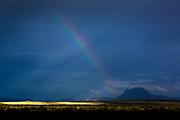A rainbow  on a dark sky somewhere outside Alpine.