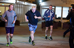 © Licensed to London News Pictures. 03/10/2017. Manchester, UK. British foreign secretary BORIS JOHNSON seen running with TONY GALLAGHER (left), editor of The Sun newspaper, ahead of his speech on day three of the Conservative Party Conference. The four day event is expected to focus heavily on Brexit, with the British prime minister hoping to dampen rumours of a leadership challenge. Photo credit: Ben Cawthra/LNP