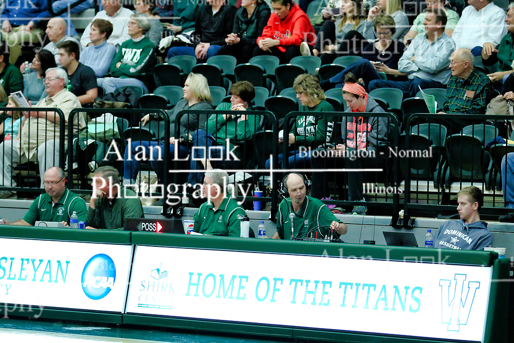 BLOOMINGTON, IL - December 15: Illinois Wesleyan Titan Men's basketball bench crew during a college basketball game between the IWU Titans  and the Carroll Pioneers on December 15 2018 at Shirk Center in Bloomington, IL. (Photo by Alan Look)