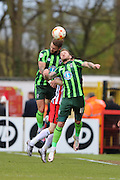 Sean Rigg forward for AFC Wimbledon (11) and Callum Kennedy defender for AFC Wimbledon (3) jump for the same ball during the Sky Bet League 2 match between Stevenage and AFC Wimbledon at the Lamex Stadium, Stevenage, England on 30 April 2016. Photo by Stuart Butcher.