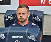 Jay Spearing takes his seat during the Sky Bet Championship match between Bolton Wanderers and Nottingham Forest at the Macron Stadium, Bolton, England on 22 August 2015. Photo by Mark Pollitt.