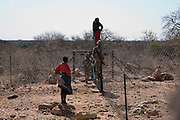 two ladies are caught by member of South Adrica military trying to cross llegally into South Africa from Zimbabwe...Zimbabweans run the gauntlet of 'jumping' the border into South Africa at Beit Bridge. Despite the tripple reinforcement of the razor wire fencing and electrification as many as one hundred Zimbabweans fleeing policital violence and starvation in Zimbabwe atempt the border crossing on a daily basis...Many are captured by the South African Armed Forces, taken to a 'holding facility' and deported back accross the border within 24 hours. Those successfully making the crossing head for Johannesburg or find work in one of the many citrus / vegetable farms adjacent to the international border.