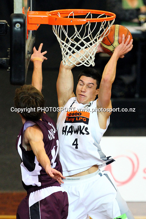 Hawks' Jarrod Kenny gets a rebound. 2010 NBL Quarter Final, Harbour Heat v Hawke's Bay Hawks, North Shore Events Centre, Auckland. Wednesday 23rd June 2010. Photo: Anthony Au-Yeung/PHOTOSPORT