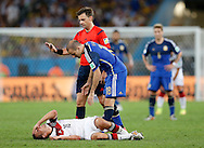 Germany's Philipp Lahm lies injured as Argentina's Rodrigo Palacio stands over him during the 2014 FIFA World Cup Final match at Maracana Stadium, Rio de Janeiro<br /> Picture by Andrew Tobin/Focus Images Ltd +44 7710 761829<br /> 13/07/2014