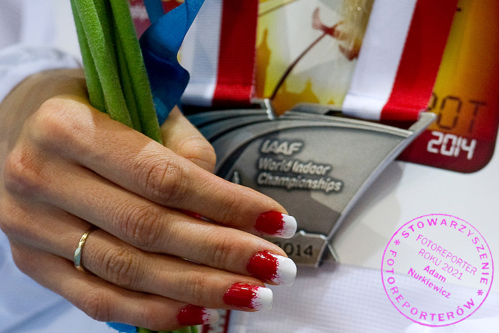 Angelika Cichocka from Poland poses with her silver medal in women's 800 meters while medal's ceremony during the IAAF Athletics World Indoor Championships 2014 at Ergo Arena Hall in Sopot, Poland.<br /> <br /> Poland, Sopot, March 9, 2014.<br /> <br /> Picture also available in RAW (NEF) or TIFF format on special request.<br /> <br /> For editorial use only. Any commercial or promotional use requires permission.<br /> <br /> Mandatory credit:<br /> Photo by &copy; Adam Nurkiewicz / Mediasport