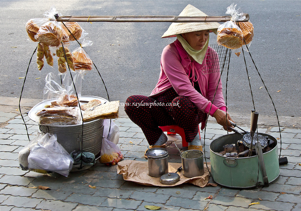 Waffles and other early morning breakfast goodies on the steets of Ho Chi Minh. - Ho Chi Minh, Vietnam - 16/11/13 - MANDATORY CREDIT: Ray Lawrence / www.raylawphoto.co.uk - Self billing applies where appropriate - 07774 985144 - raylph@virginmedia.com - NO UNPAID USE