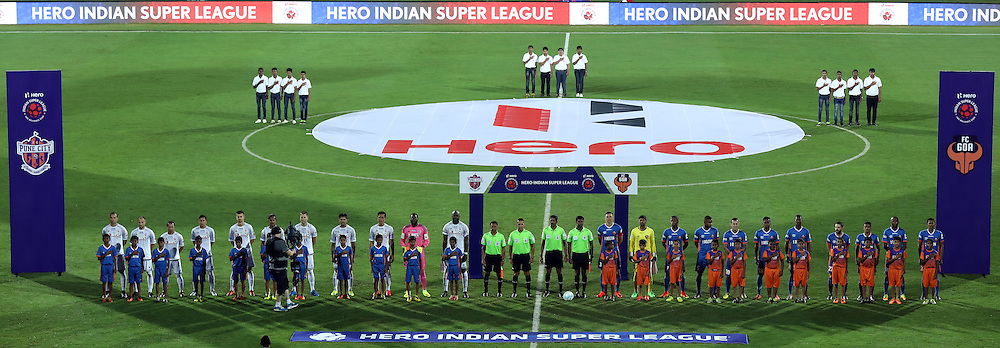 players stand for the national anthem during match 8 of the Indian Super League (ISL) season 3 between FC Goa and FC Pune City held at the Fatorda Stadium in Goa, India on the 8th October 2016.<br /> <br /> Photo by Sandeep Shetty / ISL/ SPORTZPICS
