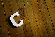 The letter C on a wood floor