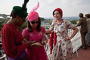 SUSAN BENDER; Daniella Issa Helayel; PEARL LOWE; , Glorious Goodwood. Ladies Day. 28 July 2011. <br /> <br />  , -DO NOT ARCHIVE-© Copyright Photograph by Dafydd Jones. 248 Clapham Rd. London SW9 0PZ. Tel 0207 820 0771. www.dafjones.com.