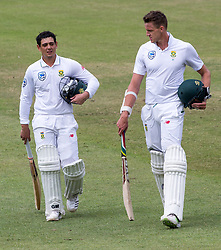 Durban. 050318. Quinton de Kock and Morne Morkel  leaves the field as Australia celebrates their victory over the Proteas during day 5 of the 1st Sunfoil Test match between South Africa and Australia at Sahara Stadium Kingsmead on March 04, 2018 in Durban, South Africa. Picture Leon Lestrade/African News Agency/ANA