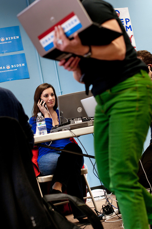Volunteer Cassandra Gaddo on the phone with voters at Obama's headquarters in Chicago prior to the election