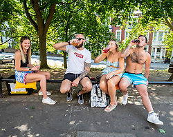 © Licensed to London News Pictures. 23/06/2020. London, UK. A group of friends celebrate pubs opening soon with a takeaway beer in Richmond Hill in South West London as forecasters predict a hot week ahead with temperatures expected to reach over 30c. Prime Minister, Boris Johnson has announced that tourism and hospitality including pubs, restaurants and campsites can now reopen from the 4th of July as well as reducing the 2 metre rule to 1 metre.  Photo credit: Alex Lentati/LNP <br /> <br /> *Permission Given*