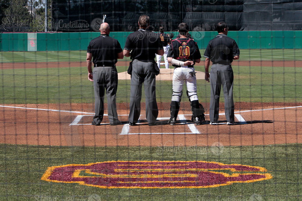 28 March 2009: Catcher #10 Kevin Roundtree stands with umpires at home plate during the national anthem before the USC Trojans Baseball team during a 10-1 loss to Arizona State Sun Devils at Dedeaux Field in Los Angeles.