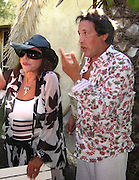 **EXCLUSIVE**.Joan Collins and Ron Kass at Club 55 .St. Tropez, France..Sunday, July 29, 2007.Photo By Celebrityvibe.com.To license this image please call (212) 410 5354; or.Email: celebrityvibe@gmail.com ;.