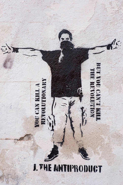 Revolutionary graffiti wallpainting on the wall of a building in Arles, France