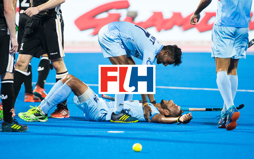BHUBANESWAR - Hockey World League finals Match for bronze , Germany v India (1-2). Sunil Sowmarpet (Ind) scored and celebrates with Manpreet Singh (Ind) .   COPYRIGHT KOEN SUYK
