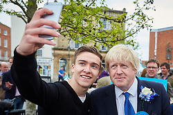 © Licensed to London News Pictures.  02/05/2015. ABINGDON, UK. Boris Johnson poses for a selfie while campaigning in Abingdon with Nicola Blackwood (not seen) who is standing for re-election as MP for the Oxford West and Abingdon constituency. Photo credit: Cliff Hide/LNP
