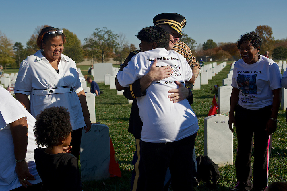 ARLINGTON, VA - NOVEMBER 11: Lt. Col. Thomas Helms, the senior Army Chaplain at Arlington National Cemetery, hugs Paula Davis, the mother of Pfc. Justin Davis, who died in Afghanistan when he was 19 years old on Veteran's Day at Arlington National Cemetery on November 11, 2012 in Arlington, Virginia.