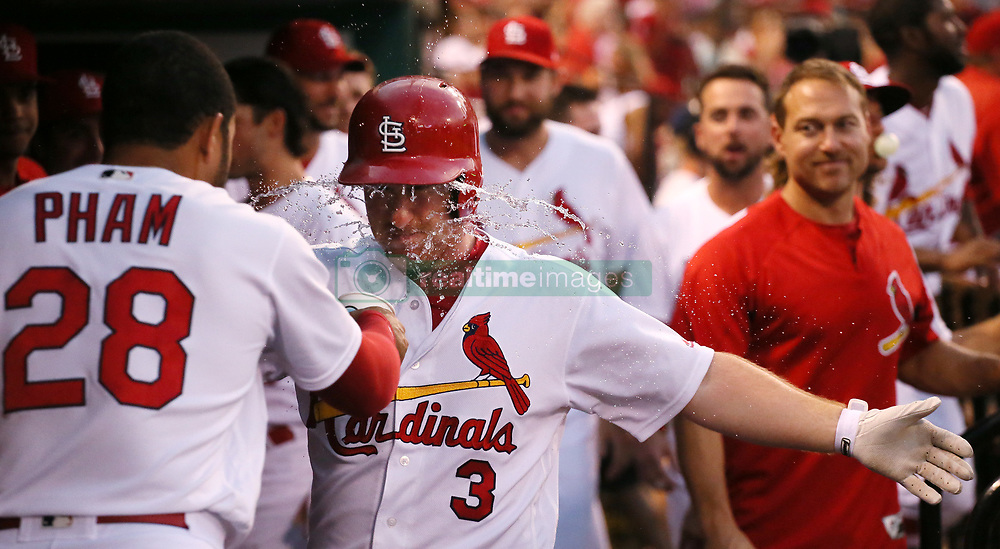 July 7, 2017 - St Louis, MO, USA - The St. Louis Cardinals' Jedd Gyorko (3) is doused by teammate Tommy Pham in the dugout after he hit a solo home run in the fourth inning against the New York Mets on Friday July 7, 2017, at Busch Stadium in St. Louis. The Mets won, 6-5. (Credit Image: © Chris Lee/TNS via ZUMA Wire)
