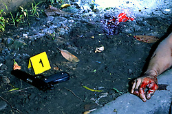 October 8, 2016 - Quezon City, Philippines - (EDITORS NOTE: Image depicts death.) Notorious top number 1 drug dealer Alias Jessie Hudas with his caliber 45 gun died during a buy bus operation was conducted by Masambong Quezon City Police officers in West River Side cor Senador st. in Delmonte Quezon City on October 8, 2016. It's part of the total out war campaign by the government about illegal drugs. (Credit Image: © Gregorio B. Dantes Jr/Pacific Press via ZUMA Wire)