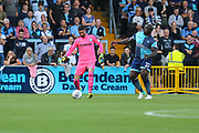 Forest Green Rovers goalkeeper Sam Russell(23) clears the ball under pressure from Wycombe Wanderers Adebayo Akinfenwa(20) during the EFL Sky Bet League 2 match between Wycombe Wanderers and Forest Green Rovers at Adams Park, High Wycombe, England on 2 September 2017. Photo by Shane Healey.