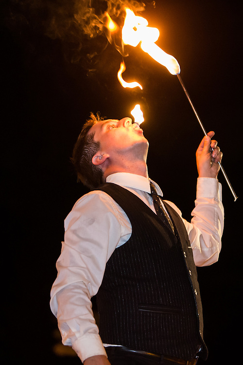 A member of the Top Hat Side Show, fire eating at Greenfield Village's Hallowe'en