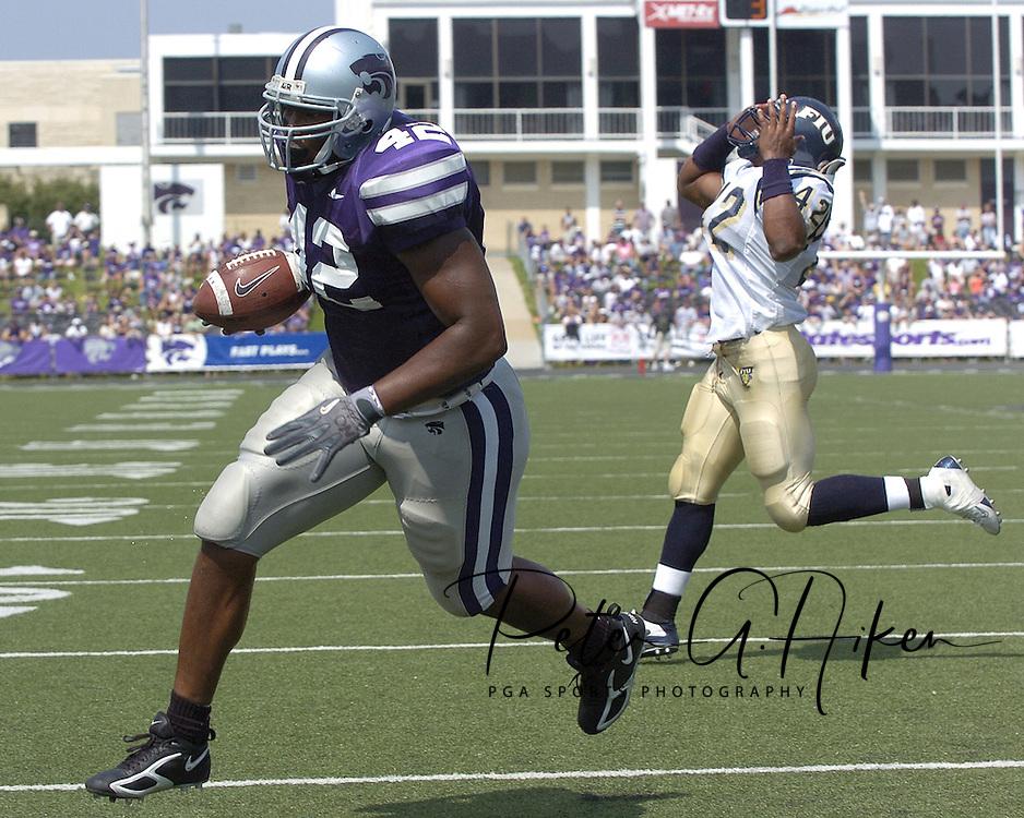 Kansas State running back Victor Mann (42) scores the Wildcats first touchdown, as Florida International's Antwan Barnes (42) reacts in the second quarter.  Kansas State defeated Florida International 35-21 at KSU Statdium in Manhattan, Kansas on September 3, 2005.