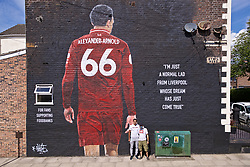 LIVERPOOL, ENGLAND - Thursday, August 8, 2019: Liverpool's Trent Alexander-Arnold poses for photograph with the artist Aske P19 in front of mural of himself on the side of a building in Sybil Road, Anfield. The mural was commissioned by The Anfield Wrap and painted by local artist Akse P19. (Pic by David Rawcliffe/Propaganda)
