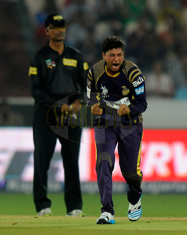 Kuldeep Yadav of Kolkata Knight Riders celebrates the wicket of Craig Simmons of Perth Scorchers during match 10 of the Oppo Champions League Twenty20 between the Kolkata Knight Riders and the Perth Scorchers held at the Rajiv Gandhi Cricket Stadium, Hyderabad, India on the 24th September 2014<br /> <br /> Photo by:  Pal Pillai / Sportzpics/ CLT20<br /> <br /> <br /> Image use is subject to the terms and conditions as laid out by the BCCI/ CLT20.  The terms and conditions can be downloaded here:<br /> <br /> http://sportzpics.photoshelter.com/gallery/CLT20-Image-Terms-and-Conditions-2014/G0000IfNJn535VPU/C0000QhhKadWcjYs